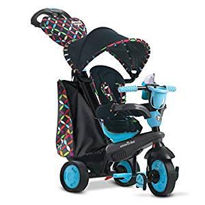 Smart trike tricycle 4 en 1 qui est de couleur bleu avec des motifs.