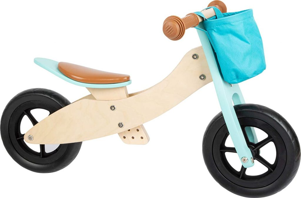 Cette draisienne à 3 roues évolutive en bois Small Foot est de couleur bleue.