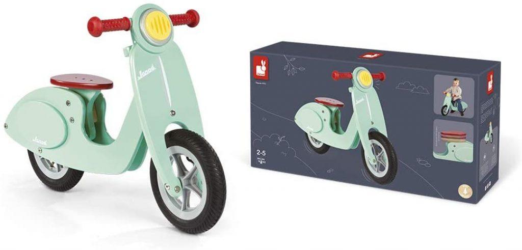 Ce vélo sans pédale Janod est de couleur vert menthe.